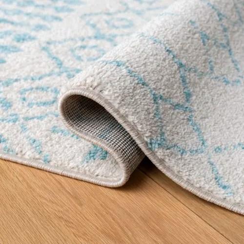 tapis de salon boheme chic ivoire et turquoise 160x228 maisons du monde