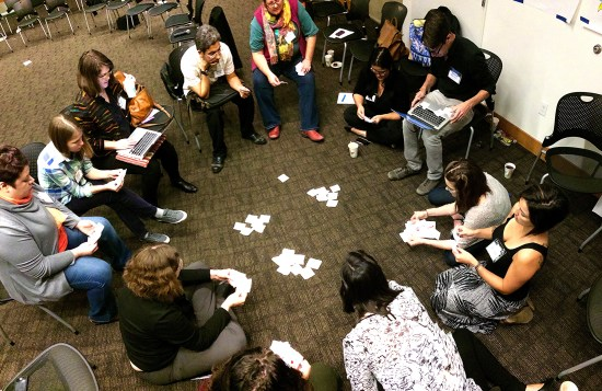 "Breakout group using the classic card game ""go fish"" as a method to cluster ideas. Photo by Andrew DeVigal"