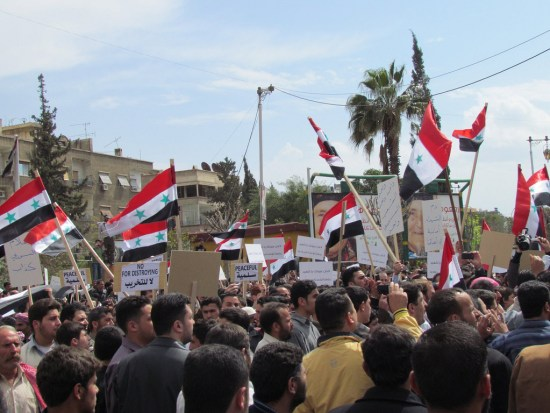 A demonstration in Douma, a Damascus suburb, against the Assad government in April 2011. Photo by user Tonemgub2010 on Wikimedia Commons via Flickr, and reused here with Creative Commons license.