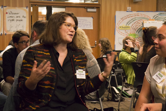Meghann Farnsworth, left, talks with other participants at Experience Engagement. Photo by Emmalee McDonald.
