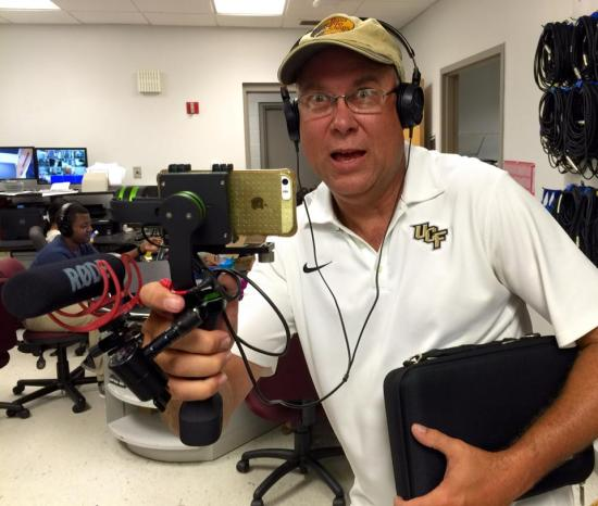 UCF journalism instructor Rick Brunson uses a gimbal to stabilize his video and an external microphone to improve sound quality.