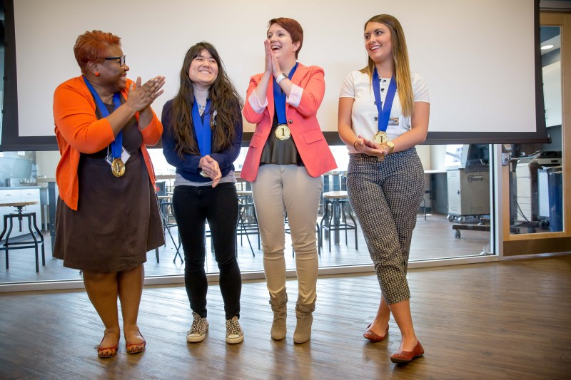 Team Clothespin celebrates its win after hearing from the judges. (Photo by David Smith/WVU Reed College of Media)