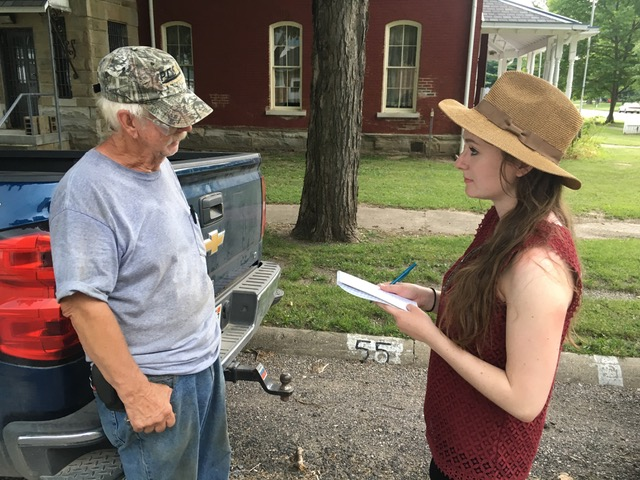 Mahoney interviews a local to Newport, Indiana about the prevalence of voter purges in his county. Photo by Emily Mahoney.
