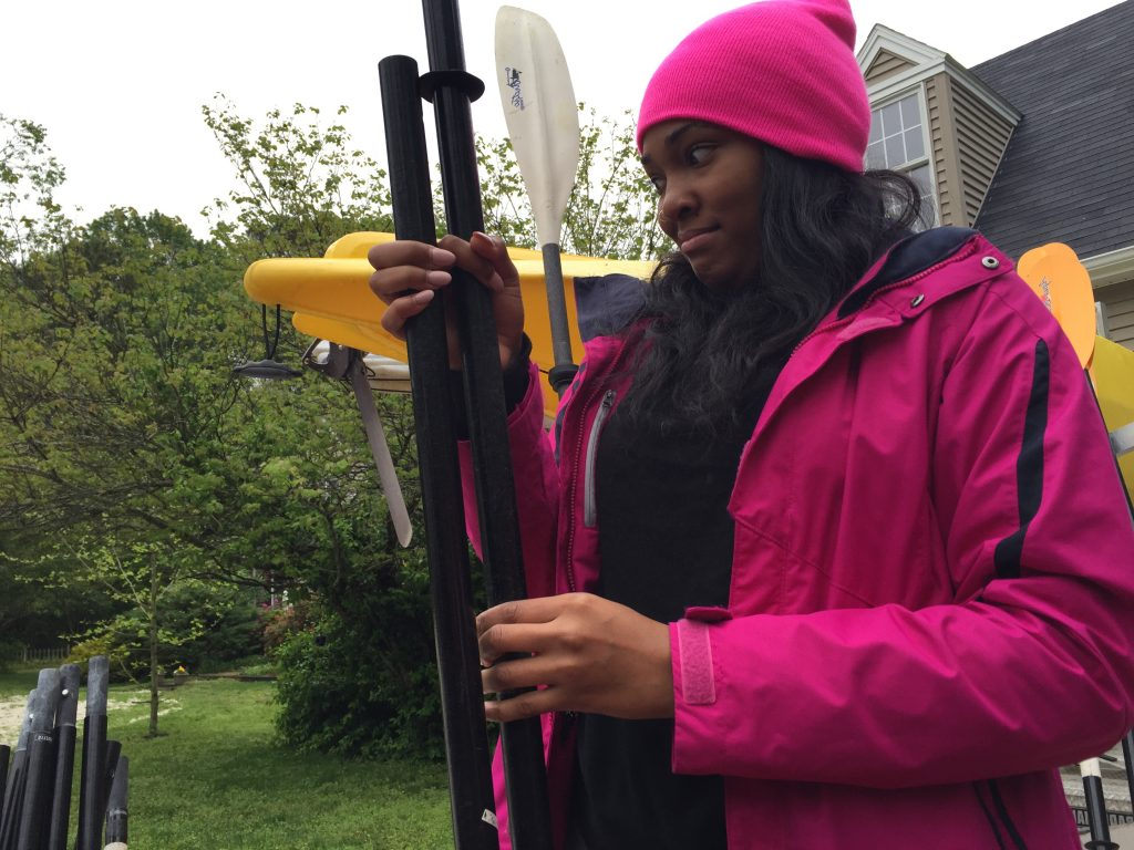 Student Alexie Malloy nervously puts together the pieces of her paddle in anticipation of the kayak trip.