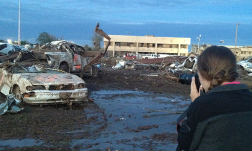 OU senior Kenzie Meek-Beck covers the tornado devastation for The New York Times. Photo by Jessica Bruno.