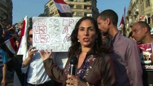 "VOA correspondent Sharon Behn reporting Sunday, July 7th from Tahrir Square in Cairo, Egypt, where protesters gathered to celebrate what they call the ""Second Revolution"" - the military's ouster of President Mohamed Morsi. VOA photo."