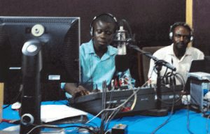 Radio journalists in Ghana use the latest equipment to broadcast to rural audiences. (Photo courtesy of Farm Radio International using a Creative Commons license.)