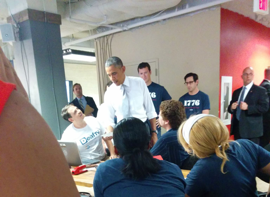 Travis Dougherty of DeafTV and an AU MAME alum, meets the president at 1776 in early July. Photo by Christine Laccay.