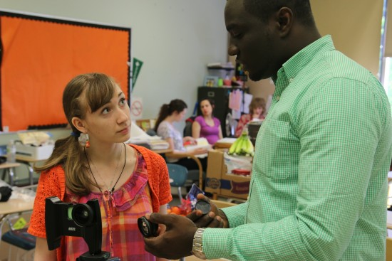 Jonas Anim, a UO undergraduate student mentors Olivia, who is a senior at Roosevelt High. Photo by Ed Madison.