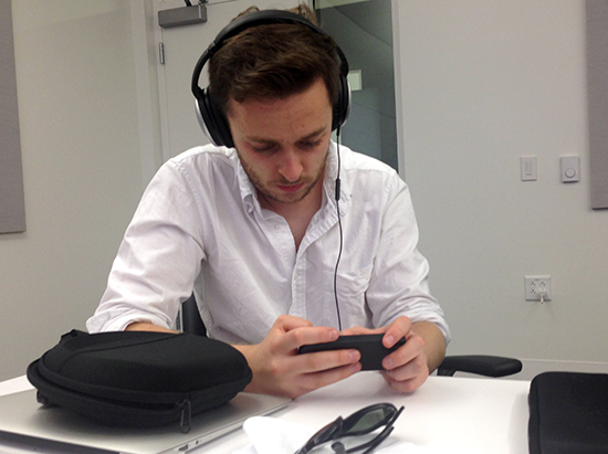 Graduate student David Hodari edits on his mobile phone