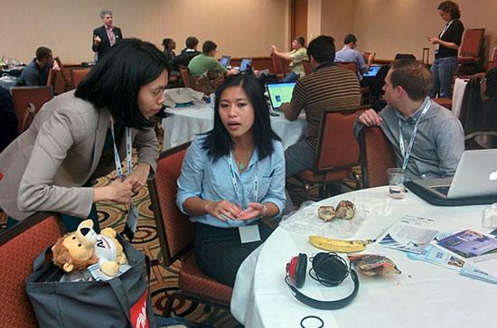 ONA Student Newsroom mentor, Leezel Tangalo, CNN Money, consults with student reporter , Anotinette Siu, Berkeley. (ONA Newsroom)
