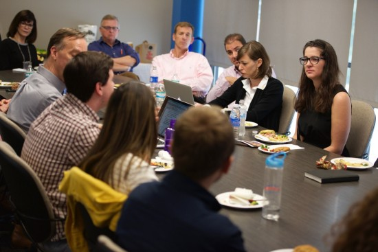 Melissa Bell, top right, in a discussion with UF's College of Journalism and Communications faculty and students. Photo by Steve Johnson.