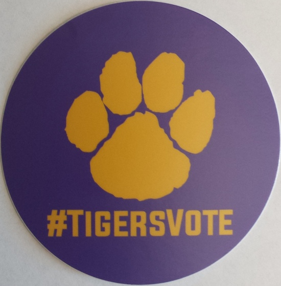 Andrew Abad and Robyn Stiles are promoting their #TigersVote hashtag by distributing stickers to LSU students.
