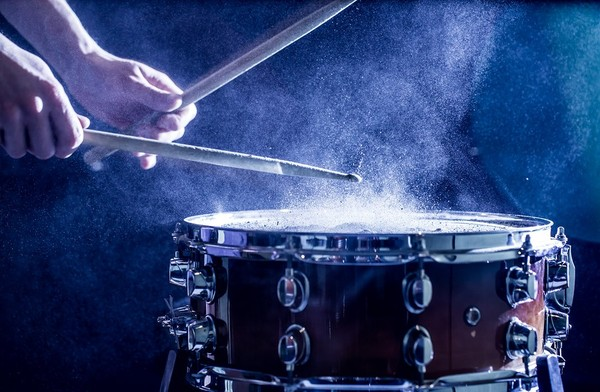 Person playing a snare drum.
