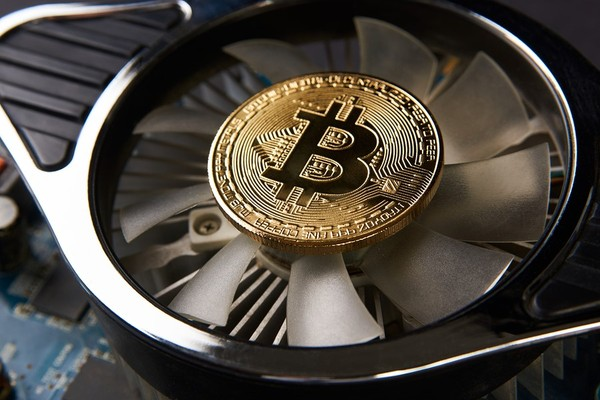 Computer fan with a gold bitcoin coin in the center.