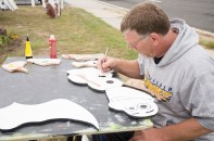 """Levittown, NY - """"A lot of people came up to me and said, 'you should do Olaf,'"""" Tom Slattery of Bethpage, NY said at the Country Craft Fair at Good Shephard Lutheran Church on Saturday, September 13, 2014. """"I'm going to make six, seven, or eight of them and have an army of Olafs on my front lawn."""" Slattery only started cutting and painting wooden signs a month prior to the fair."""