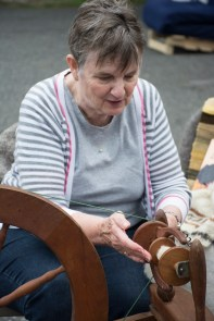 Stony Brook, NY-- Stevie Morris, a fiber artist from Port Jefferson, demonstrates how to spin wool into scarves at the Apple Festival in Stony Brook on September 13, 2014. By Ashley Maisano.