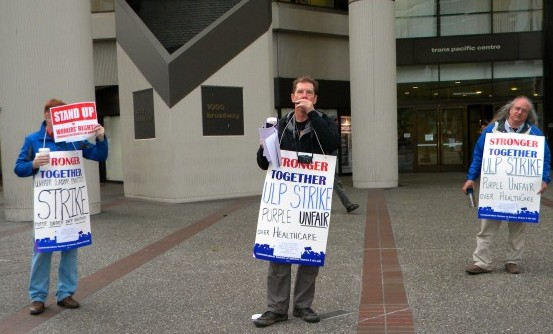 American Sign Language interpreter members of Pacific Media Workers Guild Local 39521 are in a one-day ULP strike at the headquarters of Purple Communications in Oakland. Purple is a video relay service that enables hard of hearing and deaf people to make phone calls. Purple has been accused of numerous unfair labor practices and improper billing to the FCC, which funds Purple's operations. Photo by Kat Anderson 2014.