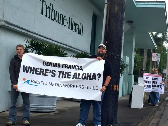 Guild members Tom Callis and Nathan Christophel pose a key question to OPI honcho Dennis Francis. The Hawaii Tribune-Herald unit is in negotiations with OPI Thursday and Friday. Photo by staff 2016