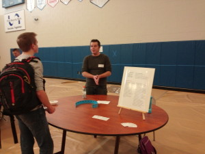 kory speaking to student at the career fair