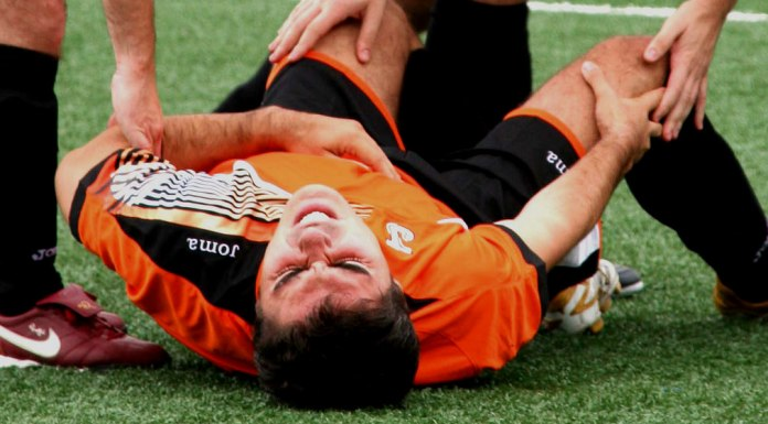A player falling on ground due to cardiac arrest