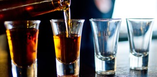 Alcohol, whisky, poured into glasses