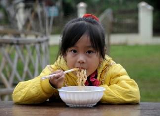 A Child having breakfast