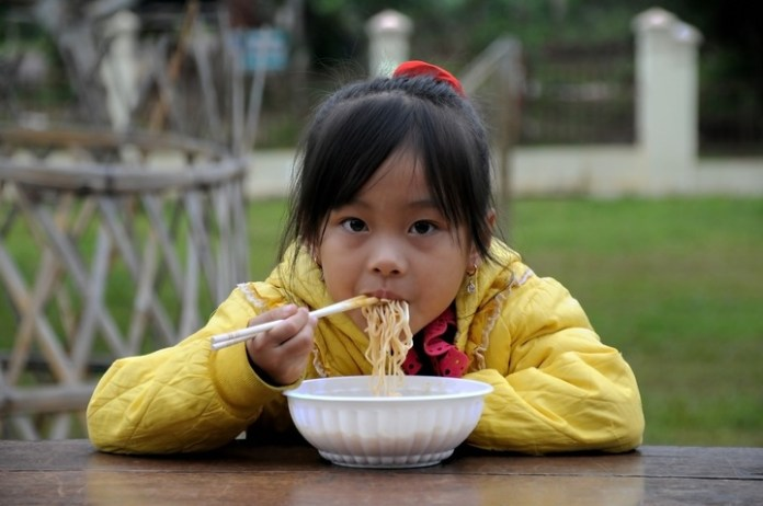 A Child having breakfast