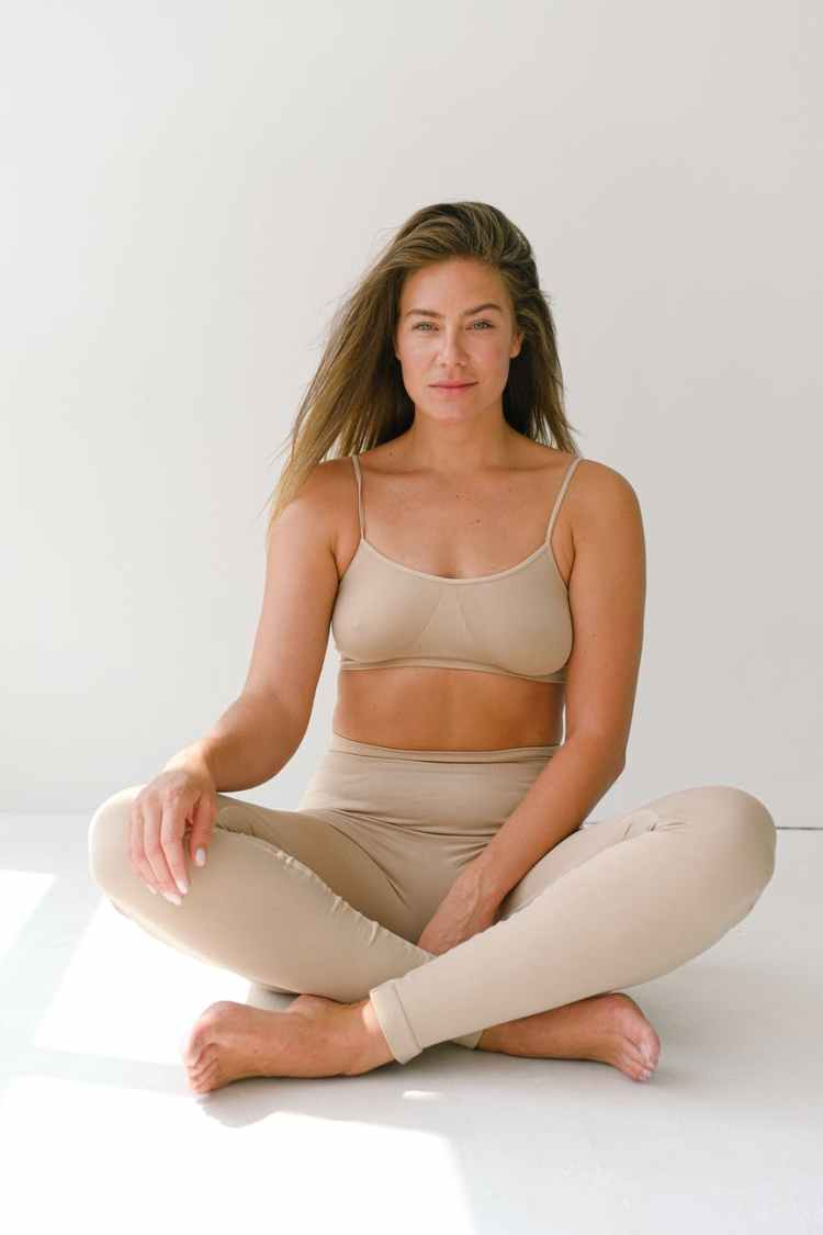 fit woman sitting in lotus pose