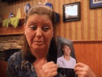 Brady Folkens mom crying with his picture