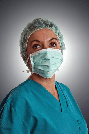 Woman doctor in mask and hospital gown perhaps wondering how MACRA will affect hospital payments under Medicare.