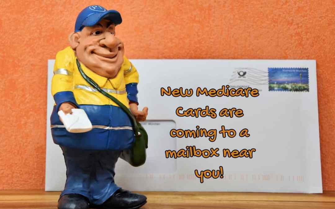 """a toy mailman with writing, """"New Medicare cards are coming to a mailbox near you"""", and an envelope with a blue stamp."""