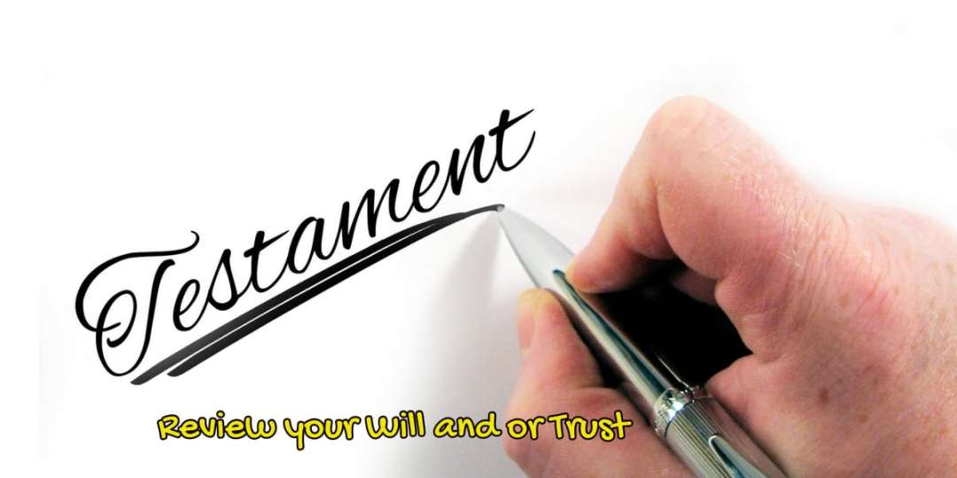 """image of someone writing the word """"testament"""" to depict Review your Will or Trust when turning 65."""