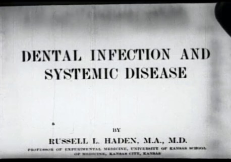 Frame from the film showing the title page of a reference book.