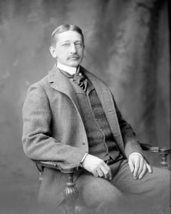 Three-quarters, full face black and white photograph of of Charles A. Powers seated in a chair.