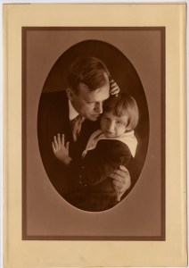Oval sepia tone photograph of Frank A. Tichenor holding his young son in his left arm.