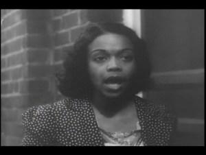 An black woman speaks.