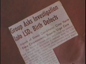 A clipped newspaper article titled Group Asks Investigation into LSD, Birth Defects