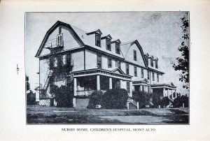 A photograph of a four-story Dutch Colonial style with multiple dormers .