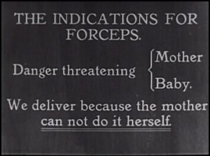 Film still of intertitle reading The Indications for Forcepts: Danger threatening Mother Baby. We deliver because the mother can not do it herself.