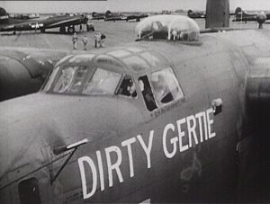 "An airplane with ""Dirty Gertie"" painted on the side on an airfield."