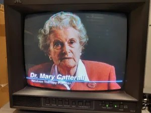 an old television with an old lady (Dr. Mary Catterall) on it