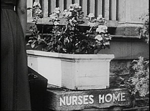 A flowerbox and sign reading Nurses Home.