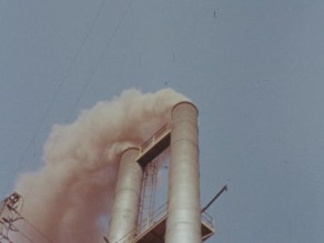 Smokestacks emitting a cloud of smoke.