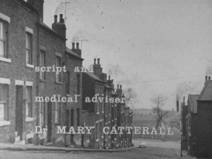 old building with credits on top 'script and medical adviser Dr Mary Catterall'