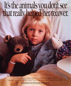 a little girl in a hospital bed holding a teddy bear and a stuffed toy rabbit