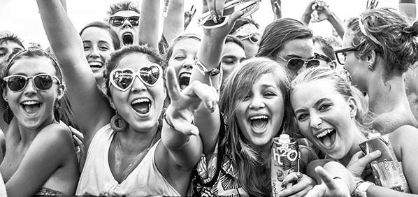 Black and white photo of young girls excited at a concert by Lotus Caroll