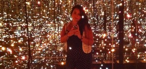 photo of Jacque Donaldson in a Yayoi Kusama infinity room