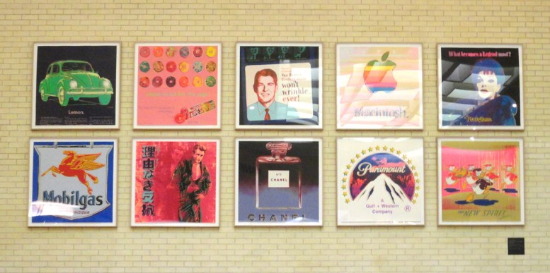 photograph of 10 Andy Warhol serigraphs in a 5 x 2 grid on a wall in Texas
