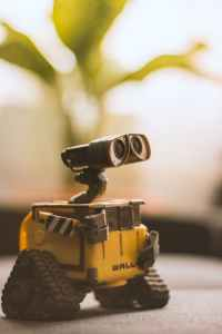 wall e toy on beige pad